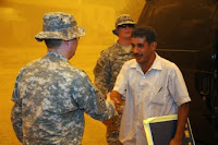 The Sons of Iraq meet with U.S. Soldiers for reconciliation at Joint Security Station War Eagle, in Baghdad.