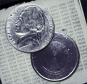 Hollowed nickel of Soviet spy Reino Hayhanen. Image taken from http://www.fbi.gov/page2/june04/060704nickel.htm