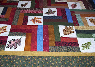 The borders for this leaf quilt will be gold and green.