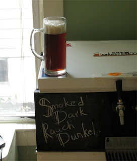 Smoked Dunkel - Rauch Dark Lager.  Nice red color when held to the light.