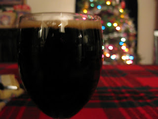 Stout foreground on a Christmas tree background.