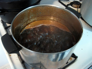 Reducing the first runnings from the Scottish Stout on the stove.