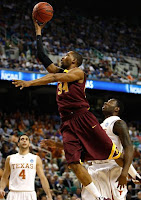 Golden Gophers Basketball Player taking it to the hoop