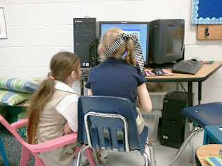 two students in front of a computer