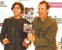 Band members Ferman Akgül and bassist Cem Bahtiyar of maNga with MTV award