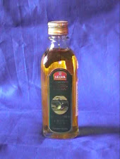 EXTRA VIRGIN OLIVE OIL. hARGA rP. 25.000;