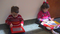 Children playing etch-a-sketches