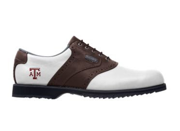 Texas A & M golf shoe that is brown and white with a red school logo near the heel above the soft rubber cleats.