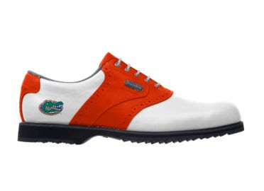 Orange Florida Gators golf shoe for men with the angry Albert mascot logo on the heel above black cleats.