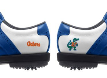 University of Florida golf shoes with college logos of friendly Albert mascot and Gators written in orange.