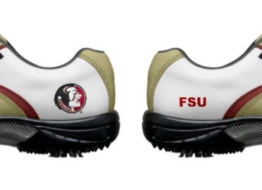 Florida State University Golf Shoes with one round logo and the letters FSU in red around on white above sporty rubber soles and cleats.