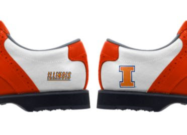 University of Illinois golf shoes with one logo of large orange letter I and another logo reading ILLINOIS in orange text on a white background.