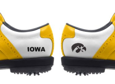 University of Iowa golf shoes for men with an IOWA logo on one heel and a Hawkeyes black logo on the other heel of these size 11 shoes with rubber spikes and yellow trim on a classic white style.