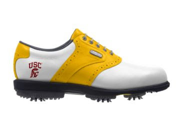 University of Southern California golf shoe that is gold and white with a crimson logo on the back near the heel above the soft rubber cleats.