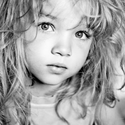 I simply adore black and white photography. Close up faces