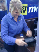 Erin Holton activating a new iPhone while working at Best Buy