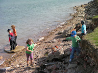 throwing rocks in the sea from coastal defences on reclaimed land