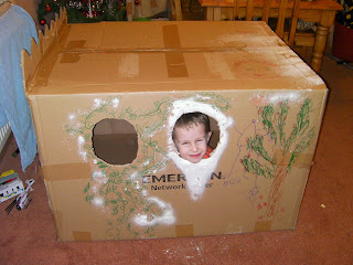 Santa in a large cardboard shipping box