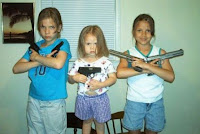 kids posing with guns