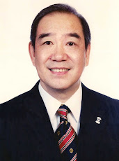 International President  Wing-Kun Tam
