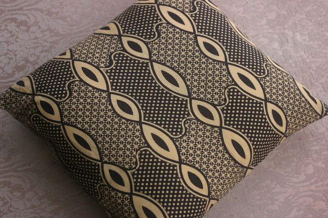 Almofada feita de capulana