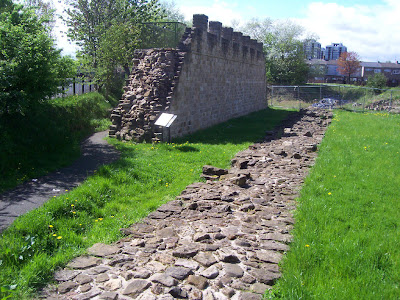 Original remains next to a reconstruction
