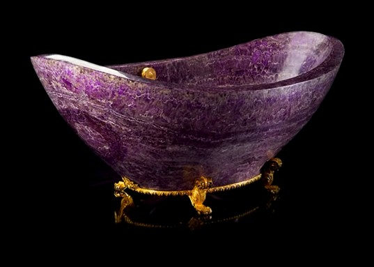 is a stand-alone tub made of amethyst, one of the most precious stones ...