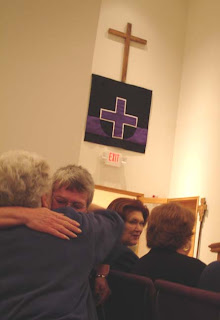 hugging in church