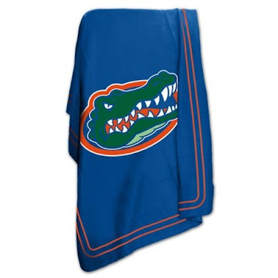 U of Florida sweatshirt blanket that is blue with a Green Gators head.