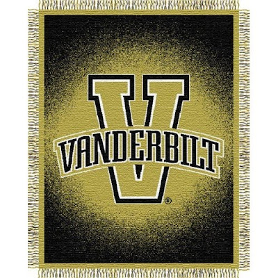 Gold and black Vanderbilt blanket with letter V logo.