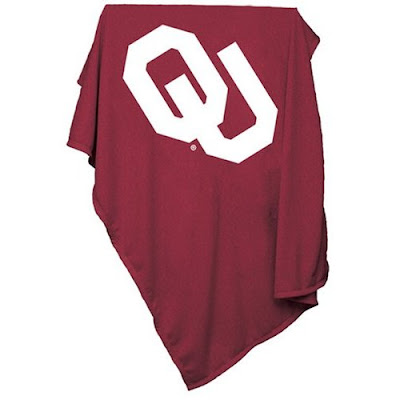 Crimson OU sweatshirt blanket with white writing.
