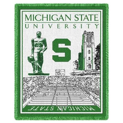 Michigan State tapestry with Beaumont Tower, The Spartan (Sparky) statue, and Spartan Stadium are all pictured on this green and white blanket.