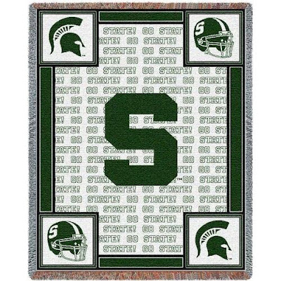 MSU Spartans white football throw blanket with green trim.