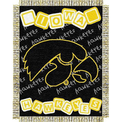 U of Iowa Hawkeyes baby blanket that is gold and black.