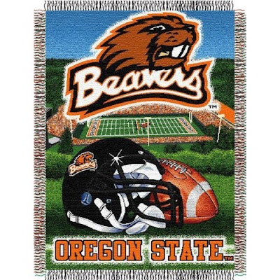 Oregon State football tapestry blanket with black football helmet, football, and Reser Stadium.