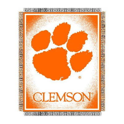 Clemson Tigers white and orange blanket with a paw print.