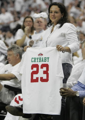 A woman holds up a Papa John's Crybaby 23 T-shirt at the Verizon Center during Friday night's game that the Wizard's lost, 105-88. — Photo by John Kuntz