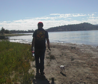 The boyfriend and the dog, strolling by the lake.