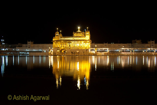 Photo of The Golden Temple at night, located in the middle of the Holy Sarovar in Amritsar