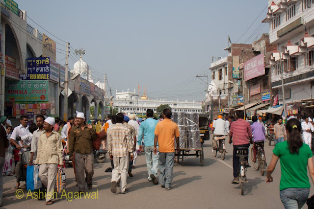 People heading towards the Golden Temple on the busy road leading to it in Amritsar
