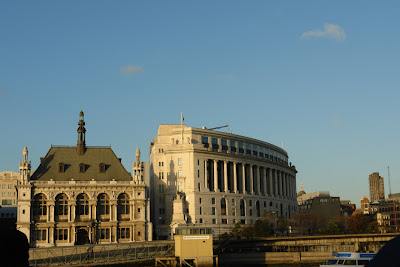 Two historic buildings next to the Thames in London