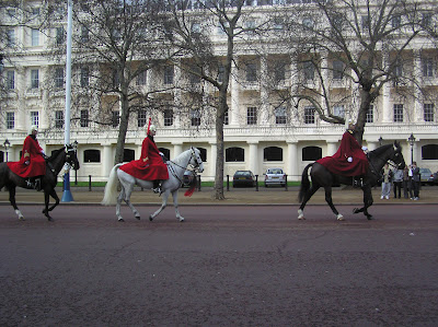 The Queen's Guard cantering along The Mall
