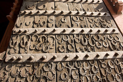 The carvings on the wooden door at the entrance to Fatehpur Sikri