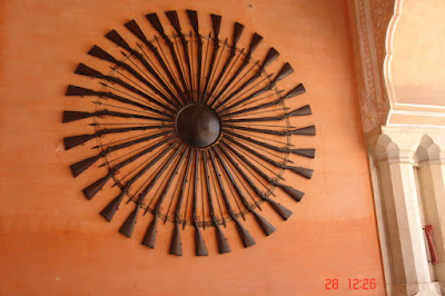 Wall display of weapons in Jaipur City Palace