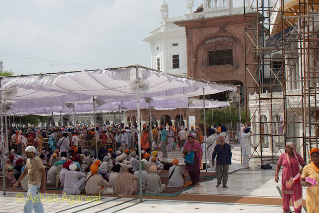 A closer, ground level view of the congregation of devotees just outside the Darshan Deori in the Golden Temple in Amritsar