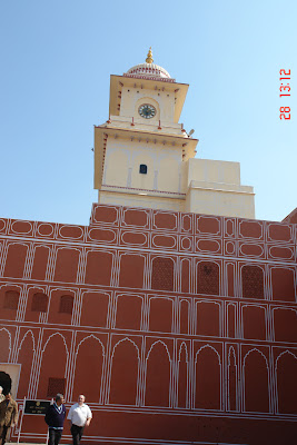 Photo of Building rising above the red section in Jaipur City Palace in India