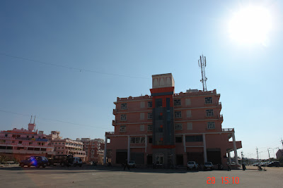 Photo of a separate building under harsh sun