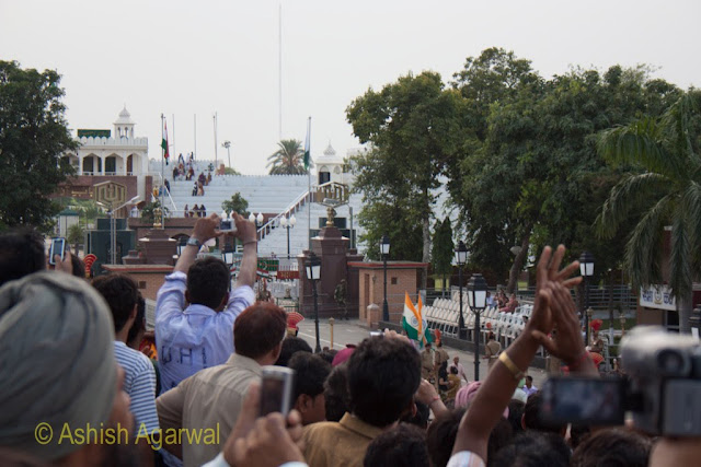 Watching the flag lowering ceremony between India and Pakistan over the heads of a huge crowd at the Wagah Border