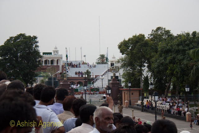 View of the Wagah Border between India and Pakistan, along with people on the Pakistani side