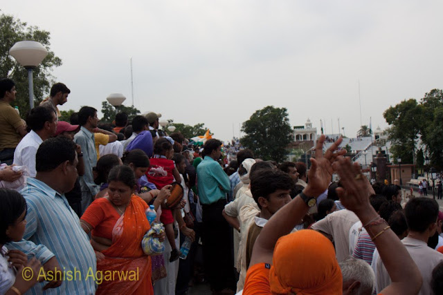 People all standing up in the stands to get a better view of the Wagah Border ceremony